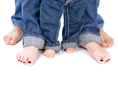 barefoot people: Family unity, abstract border, barefoot people legs isolated on white