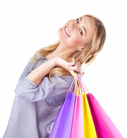 Closeup portrait of cheerful young lady enjoying new purchase, isolated on white background, positive facial expression, sales concept photo
