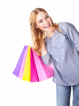 gift spending: Excited shopper, cheerful girl holding in hand colorful gift bags isolated on white background, hobby of spending money, sales concept