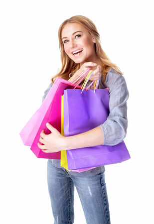 Excited female with shopping bags isolated on white background, doing purchase with pleasure, money spending and seasons sales concept photo