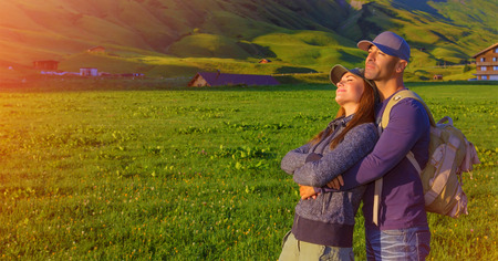 Loving couple enjoying sunset in the mountains, Alps, Austrian mountain, summer adventure, active family, romantic travel in Europe  photo
