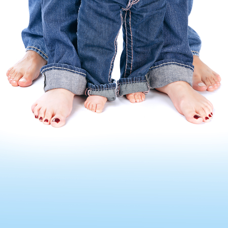 blue jeans: Family generation, abstract border, mom and dad with small kid wearing jeans isolated on white&blue background, body part, barefoot legs, love concept