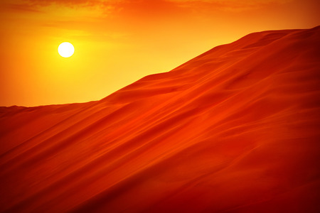 Desert sunset landscape, hot dry wilderness, beautiful panoramic scene, sandy orange hills, extreme travel, heat concept photo