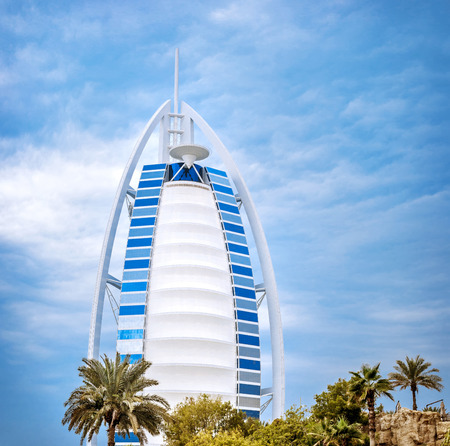 DUBAI, UAE - FEB 09: Burj Al Arab is 321m, second tallest hotel in the world, luxury hotel stands on an artificial island, February 09 ,2014 Jumeirah beach, Dubai, United Arab Emirates photo