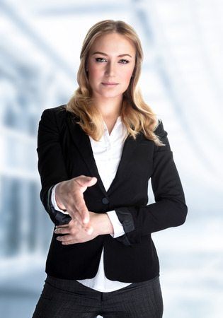 vp: Portrait of cute blond girl stretches out her hand for a handshake, work in great financial company, young business professional make a deal