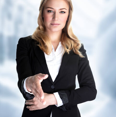 bargain: Closeup portrait of attractive business woman stretches out her hand for a handshake with partner, make a bargain, successful career concept