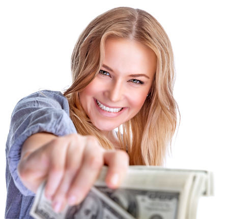 gift spending: Portrait of cute happy girl holding in hand a lot american dollars, isolated on white background, spending money concept Stock Photo