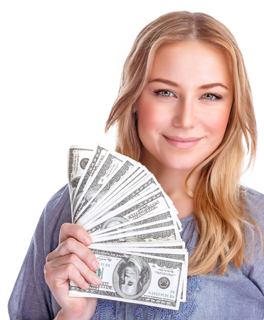spending money: Portrait of cute happy girl holding in hand a lot american dollars, isolated on white background, spending money concept Stock Photo