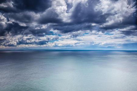 Overcast weather over sea, dark dramatic cloudy sky,\ dangerous seascape, panoramic landscape