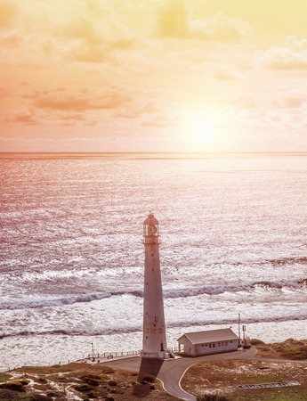 punt: Lighthouse, beautiful seascape, Kommetjie at Slangkop Punt near Cape Town, nature of South Africa, Western Cape