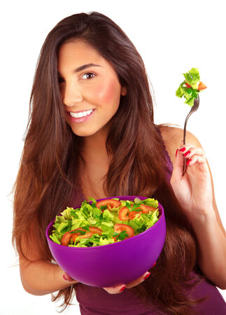 Sportive girl eating fresh vegetarian salad isolated on white background, loss weight, healthy nutrition, body care and beauty concept Stock Photo - 27821978
