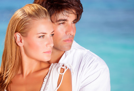lovely couple: Closeup portrait of lovely couple looking in side on blue sea background, boyfriend and girlfriend enjoying summer vacation