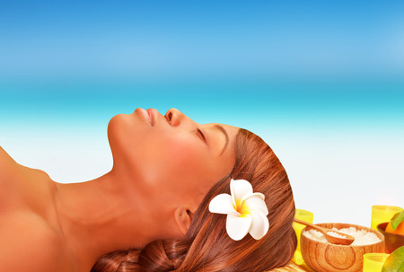 Closeup portrait of attractive African woman lying down on massage table on the beach in luxury spa resort, summer vacation concept photo