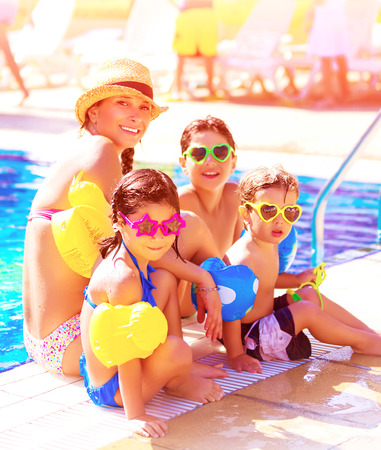 resort beach: Big cheerful family having fun on beach resort, active lifestyle, spending time together near poolside, summer vacation and traveling concept Stock Photo
