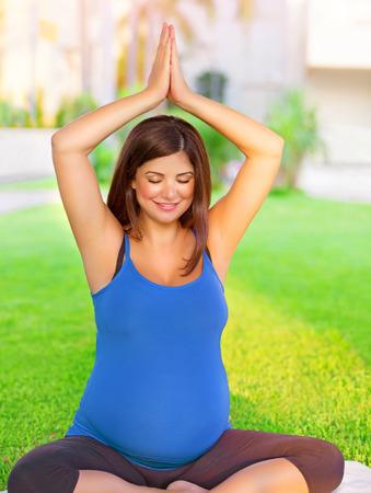 Happy pregnant woman do fitness photo