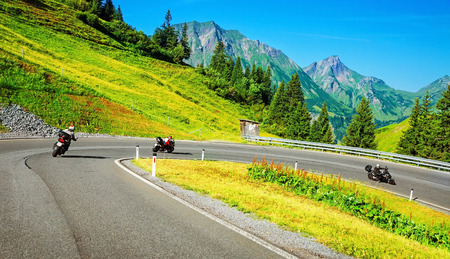 motorcyclist: Motorbikers group in mountainous tour, active lifestyle, summertime adventure, extreme sport, speed concept Stock Photo