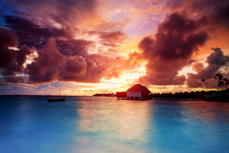 tonight: Sunset over Maldives islands, beautiful beach landscape, stunning evening seascape in orange sunset light, summer exotic holidays, travel and tourism concept Editorial