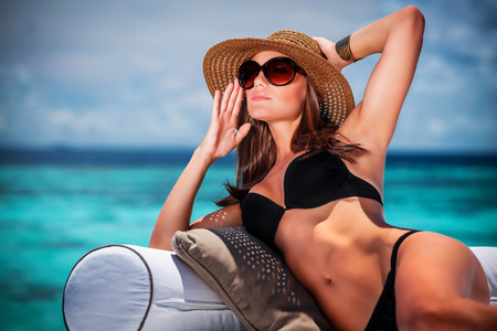 Portrait of sexy model posing on the beach, luxury photo shoot on Maldives island, fashionable look, summer vacation concept