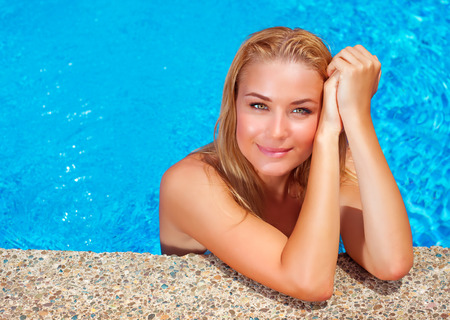 wet bikini: Female enjoying summer holidays, woman on day spa relaxation, sexy girl in the pool, luxury vacation on tropical resort, leisure and recreation concept