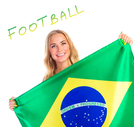 Happy woman with Brazil flag isolated on white background, text space, cheerful supporter of Brazilian  football team photo