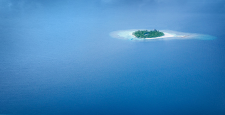 Uninhabited island in the sea from bird eye view, panoramic sea background, exotic vacation, journey and summer travel concept  photo