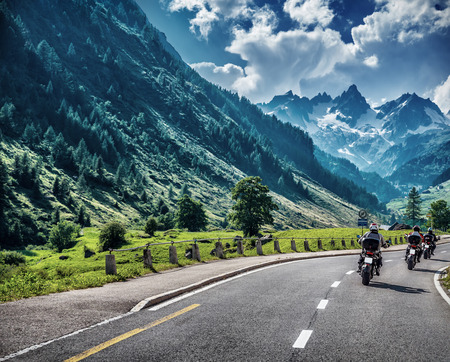 mountainous: Motorcyclists on mountainous road, enjoying tour along Alps, summertime activities, wonderful mountain landscape, extreme vacation concept