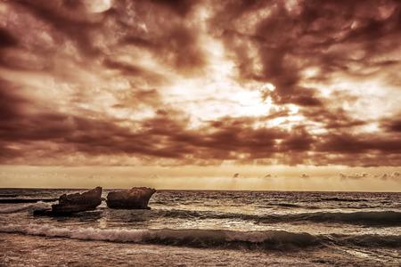 lebanon beach: Grunge style photo of cliffs in Mediterranean sea in Lebanon, dark cloudy sky, overcast weather, summer storm concept