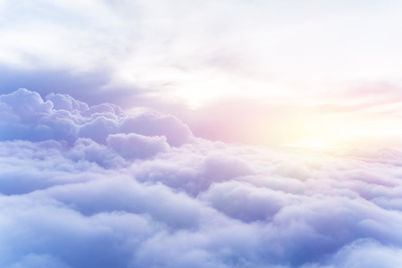 Sunny sky abstract background, beautiful cloudscape, on the heaven, view over white fluffy clouds, freedom concept Standard-Bild