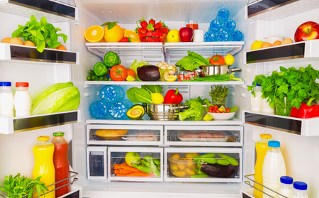 refrigerator: Open fridge full of fresh fruits and vegetables, healthy food background, organic nutrition, health care, dieting concept Stock Photo