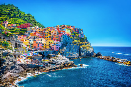 mediterranean houses: Beautiful colorful cityscape on the mountains over Mediterranean sea, Europe, Cinque Terre, traditional Italian architecture Stock Photo
