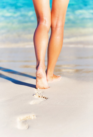 foot step: Summer holidays concept, closeup photo of a sexy womans legs, slim female walking on the beach, carefree lifestyle, summer vacation background, relaxation and life joy