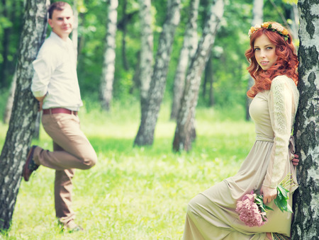 Romantic gentle bride and handsome groom posing near birch trees, beautiful young loving couple, summer time, happy wedding day concept photo