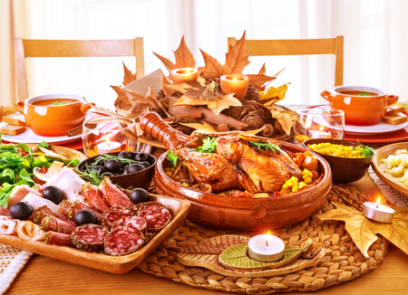 Festive Thanksgiving day dinner, celebration holiday at home, traditional homemade tasty dishes, beautiful autumnal decor photo
