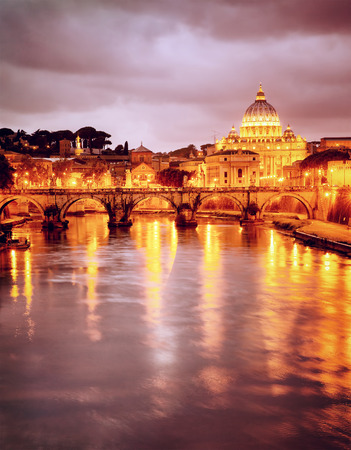 Night view at St. Peters cathedral in Vatican, Rome, Italy, beautiful reflection of illuminated catholic church, summer travel and tourism concept   photo