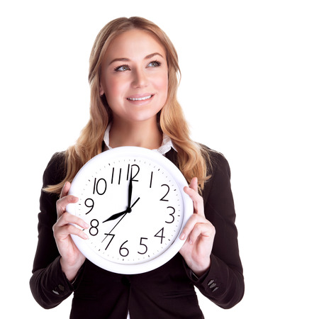 vp: Portrait of happy smiling business woman holding in hands big clock isolated on white background, regular schedule, success concept Stock Photo