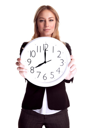 oclock: Portrait of serious business woman holding in hands big clock isolated on white background, eight oclock, get up early in the morning Stock Photo