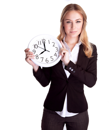 Portrait of beautiful young business woman holding in hands clock, isolated on white background, discipline and punctual concept photo