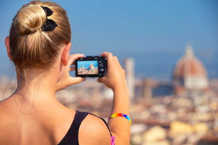 season photos: Back side of woman photographing majestic cityscape, Europe, Florence, Italy, Tuscany, travel and tourism concept
