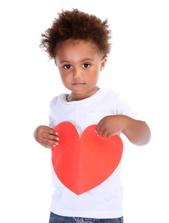 Portrait of cute little African boy with red paper heart isolated on white background, healthy lifestyle, medical treatment, hope concept photo