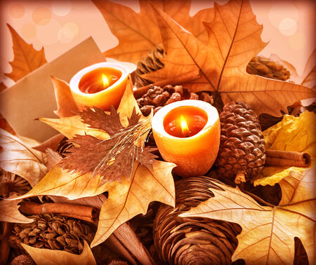 Beautiful still life for Thanksgiving day holiday, abstract natural background, greeting card, dry leaves, fir cones, two candles, happy celebration concept photo