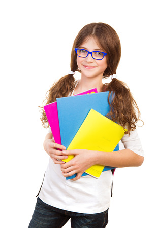 little model: Happy school girl isolated on white background, cute brunette teenager standing and holding books, pretty school kid with cheerful smile, back to school, education and knowledge concept