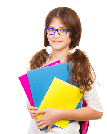 pretty preteen: Happy school girl isolated on white background, cute brunette teenager standing and holding books, pretty school kid with cheerful smile, back to school, education and knowledge concept