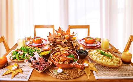 delicious: Festive dinner at home, Thanksgiving day celebration, backed chicken, cold cuts, potato garnish, fresh green salad, traditional food for autumnal holiday