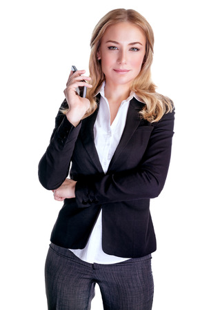 Portrait of young serious female speaking on mobile phone, isolated on white background, business people using portable device, communication concept  Imagens