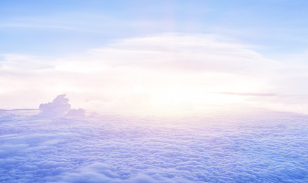 skyscape: Beautiful heaven in the morning, flying over fluffy clouds, bright sun light, peaceful landscape, good weather, freedom concept Stock Photo