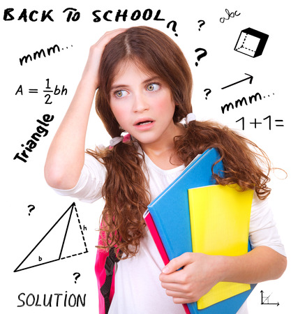 difficult task: Portrait of cute teen girl holding head by hand, difficult exam of geometry, try to find solution of task, back to school concept