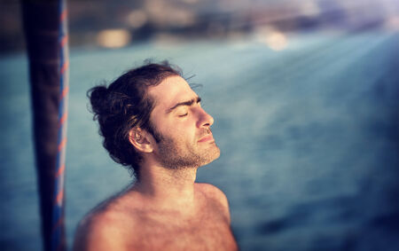 Closeup portrait of handsome man with closed eyes enjoying nature, summer adventure, travel and tourism concept