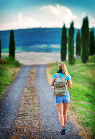 Young backpacker traveling along Europe, happy female walking in the park, discovering world, summer vacation concept photo