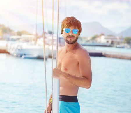 Handsome man on yacht, guy enjoying sea cruise on luxury sailboat, summertime activity, travel and tourism concept photo