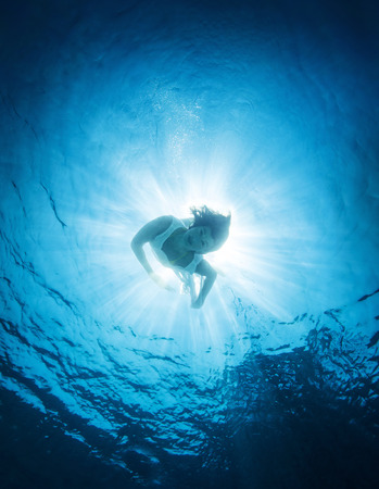 sea  scuba diving: Woman dive into the sea, active lifestyle, swimming in transparent blue water, discovering nature, summer vacation concept